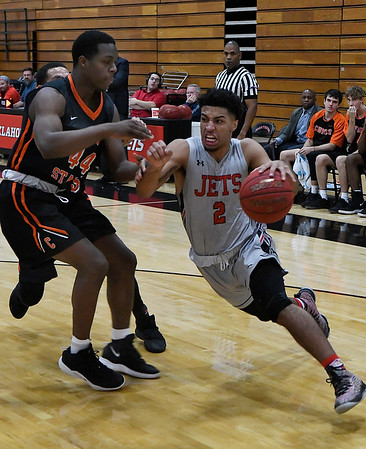 NOC Enid's Questyn Luckey drives towards the basket against Connors State's Isaiah Jones Tuesday November 27, 2018 at the NOC Mabee Center. (Billy Hefton / Enid News & Eagle)