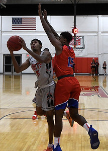 NOC Enid's C.J. Jones puts up a shot against Hutchinson CC's Rheaquone Taylor Tuesday November 6, 2018 at the NOC Mabee Center. (Billy Hefton / Enid News & Eagle)