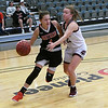 NOC Enid's Macie Jo Pierce drives to the basket against Ft. Scott's Shalina Harper during the Chick-fil-A/Northern Oklahoma College Classic Friday November 16, 2018 at the Central National Bank Center. (Billy Hefton / Enid News & Eagle)