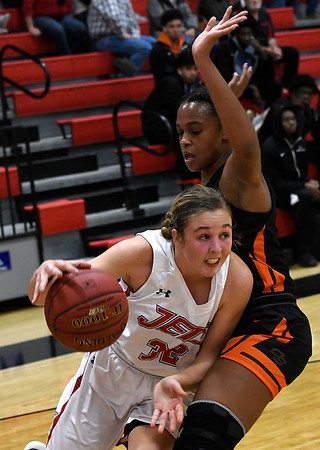 NOC Enid's Sarah Griswold drives towards the basket against Connors State's Skylah Hawkins Tuesday November 27, 2018 at the NOC Mabee Center. (Billy Hefton / Enid News & Eagle)