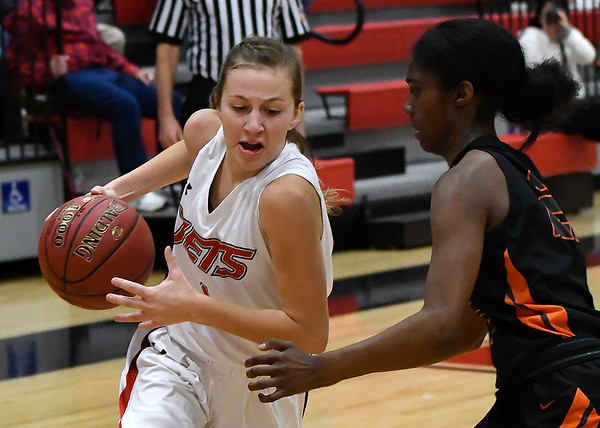 NOC Enid's Macie Pierce drives towards the basket against Connors State's Tateum Jones Tuesday November 27, 2018 at the NOC Mabee Center. (Billy Hefton / Enid News & Eagle)