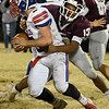 Burns Flat-Dill City's Tracen Poor is tackled by Pioneer Marzell Washington during a second round game in the Class B playoffs Friday November 16, 2018 at Pioneer High School. (Billy Hefton / Enid News & Eagle)