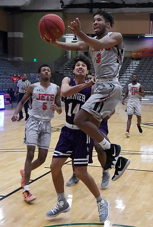 NOC Enid's Romio Harvey drives the lane in front of Ranger College's Brian Au during the Chick-fil-A/Northern Oklahoma College Classic Saturday November 17, 2018 at the Central National Bank Center. (Billy Hefton / Enid News & Eagle)