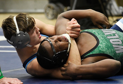 Enid's Chance Davis puts pressure on Santa Fe's Yamasi Redeagle during their 145-pound match Thursday November 29, 2018 at Waller Middle School. (Billy Hefton / Enid news & Eagle)
