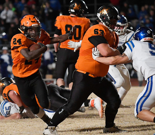 Fairview's Jadon Jones runs behind the block of keith Nelson against Commerce during the Class A quarterfinals Friday November 23, 2018 at Fairview. (Billy Hefton / Enid News & Eagle)
