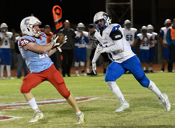 Chisholm's T.C. Smith catches a pass behind Hennessey's Juan Gonzales Friday November 2, 2019 at Chisholm High School. (Billy Hefton / Enid News & Eagle)