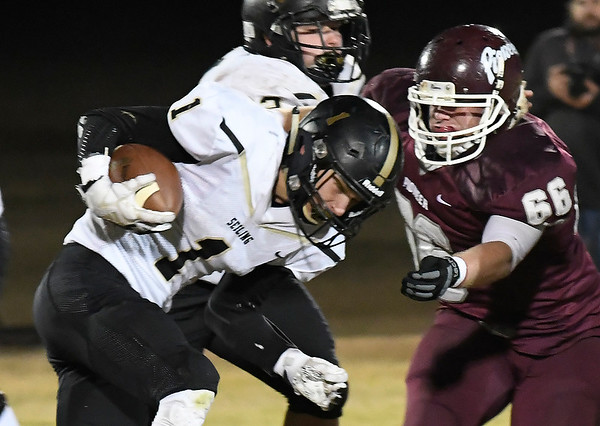 Pioneer's Dalton Schafer readies to tackle Seiling's Taylin Gilchrist during the first round of the Class B playoffs Friday November 9, 2018. (Billy Hefton / Enid News & Eagle)