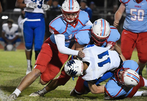 Chisholm's Nate Edwards, Krese Smith and Garrett McDowell tackle Hennessey's Kevin Suarez Friday November 2, 2019 at Chisholm High School. (Billy Hefton / Enid News & Eagle)