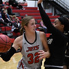NOC Enid's Sarah Griswold passes the ball around Butler's Mirands Givens Monday, November 11, 2019 at the NOC Mabee Center. (Billy Hefton / Enid News & Eagle)