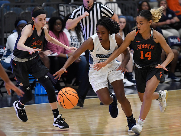 Enid's Mya Edwards dribbles upcourt against pressure from Putnam City's Kiana Willingham and Randy Brown Tuesday, November 26, 2019 during the home opener at the Stride Bank Center. (Billy Hefton / Enid News & Eagle)