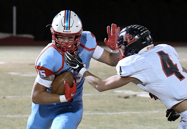 Chisholm's Nate Edwards runs against Luther's Tyler Becker after making a catch Friday, November 1, 2019. (Billy Hefton / Enid News & Eagle)