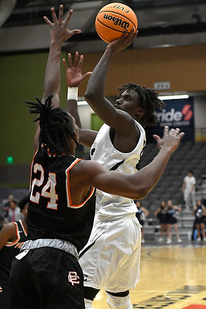 Enid's Mason Berry shoots over Putnam City's Shemar Benford-Miles Tuesday, November 26, 2019 during the home opener at the Stride Bank Center. (Billy Hefton / Enid News & Eagle)