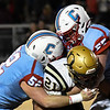 Chisholm's Hudson Fields and Keegan Goddard stops Okemah's Makhan Harjo during the first round of the Class 2A playoffs Friday, November 15, 2019 at Chisholm High School. (Billy Hefton / Enid News & Eagle)
