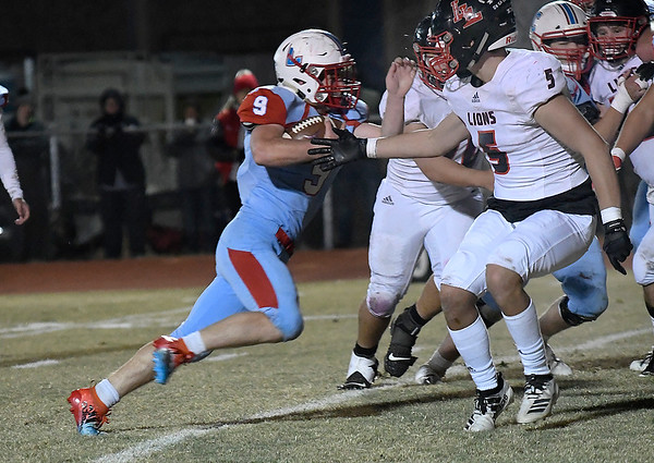 Chisholm's Lane Smith carries the ball against Luther Friday, November 1, 2019. (Billy Hefton / Enid News & Eagle)
