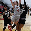 NOC Enid's Kaylee Hurst puts up a shot against Butler's RaVon Nero Monday, November 11, 2019 at the NOC Mabee Center. (Billy Hefton / Enid News & Eagle)