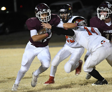 Pioneer's Rafael Torres runs through the arm of Turpin's Logan Wills during the first round of the Class B state playoffs Friday, November 15, 2019 at Pioneer High School. (Billy Hefton / Enid News & Eagle)