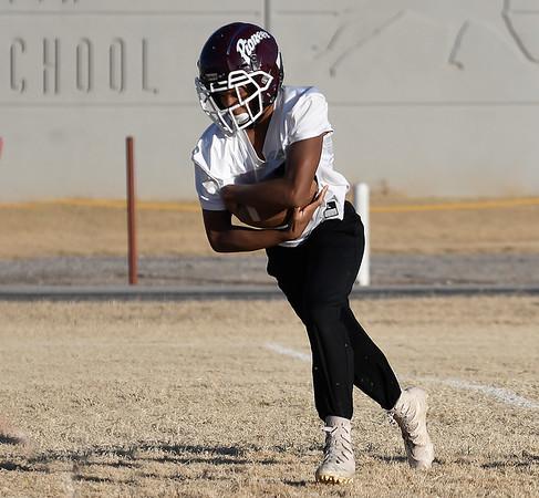 Pioneer's Marzell Washington runs the ball during a walk through practice Thursday, November 14, 2019 at Pioneer High School. (Billy Hefton / Enid News & Eagle)