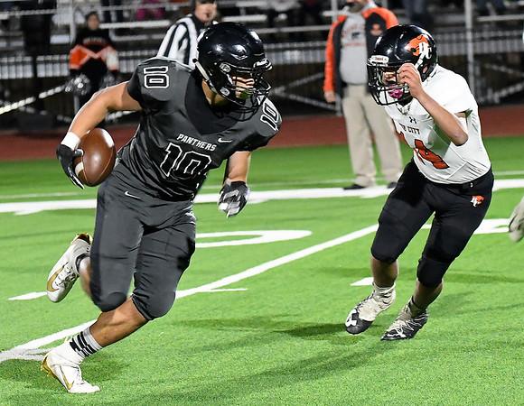 Pond Creek-Hunter's Noah Miller runs pass Boise City's Francisco Ortiz for a long touchdown Friday, November 8, 2019 at Pond Creek-Hunter High School. (Billy Hefton / Enid News & Eagle)