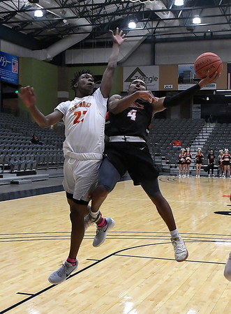 NOC Enid's Jalen Stamps goes up against New Mexico's Antonio Bridy Thursday, November 14, 2019 during the NOC/Chick-fil-A Classic at the Stride Bank Center in Downtown Enid. (Billy Hefton / Enid News & Eagle)