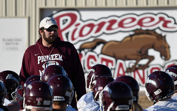 Pioneer head coach, Gus Overstreet, talks to the player following a walk through practice Thursday, November 14, 2019 at Pioneer High School. (Billy Hefton / Enid News & Eagle)