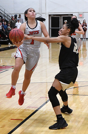 NOC Enid's Shelby Black is fouled by Butler's Miranda Givens as she drives to the basket Monday, November 11, 2019 at the NOC Mabee Center. (Billy Hefton / Enid News & Eagle)