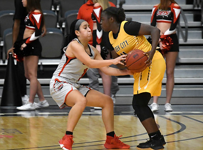 NOC Enid's Shelby Black pressures Garden City's Felicity Houston Thursday, November 14, 2019 during the NOC/Chick-fil-A Classic at the Stride Bank Center in Downtown Enid. (Billy Hefton / Enid News & Eagle)