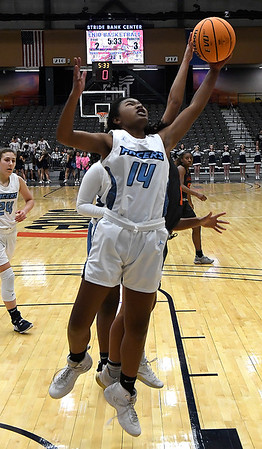 Enid's Tamira Lewis grabs a rebound against Putnam City Tuesday, November 26, 2019 during the home opener at the Stride Bank Center. (Billy Hefton / Enid News & Eagle)