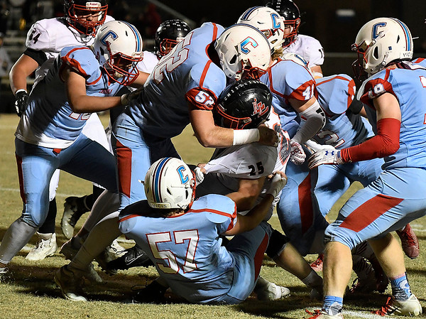 Chisholm defenders combine to stop Luther's Reed Wilson Friday, November 1, 2019. (Billy Hefton / Enid News & Eagle)