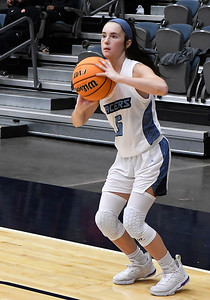 Enid'sOlivia Phillips puts up a three point shot against Putnam City Tuesday, November 26, 2019 during the home opener at the Stride Bank Center. (Billy Hefton / Enid News & Eagle)