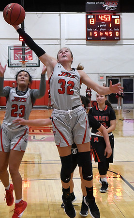 NOC Enid's Sarah Griswold grabs a rebound against Mid-American JV Monday, November 4, 2019 at the NOC Mabee Center. (Billy Hefton / Enid News & Eagle)