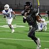 Pond Creek-Hunter's Corbin Burnham returns an interception for a touchdown against Covington-Douglas during the second round of the Class C state playoffs Friday, November 22, 2019 at Pond Creek-Hunter High School. (Billy Hefton / Enid News & Eagle)
