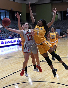 NOC Enid's Abbey Phibbs goes up for a shot between Garden City's Dasja Ross and Corina Suarez Thursday, November 14, 2019 during the NOC/Chick-fil-A Classic at the Stride Bank Center in Downtown Enid. (Billy Hefton / Enid News & Eagle)