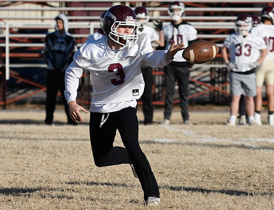 Pioneer's Ty Dennett pitches the ball on an option play during a walk through practice Thursday, November 14, 2019 at Pioneer High School. (Billy Hefton / Enid News & Eagle)