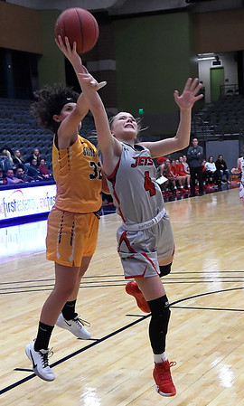 NOC Enid's Kaylee Hurst is fouled by Garden City's Corina Suarez Thursday, November 14, 2019 during the NOC/Chick-fil-A Classic at the Stride Bank Center in Downtown Enid. (Billy Hefton / Enid News & Eagle)