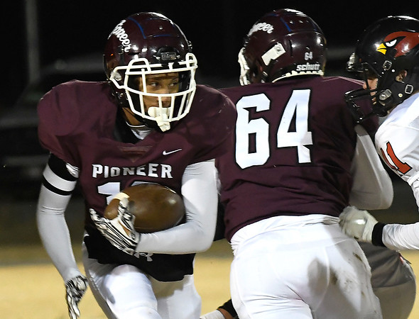 Pioneer's Marzell runs off the block of Dakota Wingo against Turpin during the first round of the Class B state playoffs Friday, November 15, 2019 at Pioneer High School. (Billy Hefton / Enid News & Eagle)