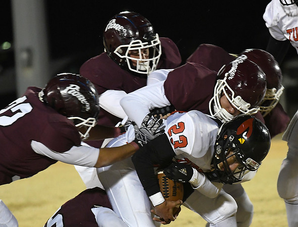 Pioneer defenders team up to stop Turpin's Aaron Resendiz during the first round of the Class B state playoffs Friday, November 15, 2019 at Pioneer High School. (Billy Hefton / Enid News & Eagle)
