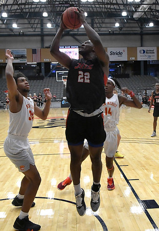 NOC Enid's Josh perkins shoots over New Mexico's Terrence Lewis Thursday, November 14, 2019 during the NOC/Chick-fil-A Classic at the Stride Bank Center in Downtown Enid. (Billy Hefton / Enid News & Eagle)