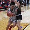 NOC Enid's Tanara Combs runs into Butler's Carissa Beck as she drives to the basket Monday, November 11, 2019 at the NOC Mabee Center. (Billy Hefton / Enid News & Eagle)