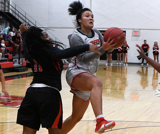 NOC Enid's Tanara Combs drives the lane against Mid-American JV Monday, November 4, 2019 at the NOC Mabee Center. (Billy Hefton / Enid News & Eagle)