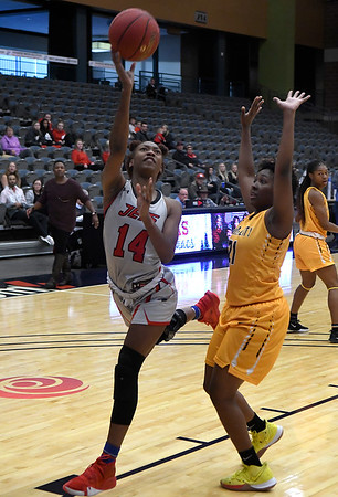 NOC Enid's Euresia Brown gets around Garden City's Tyla Happer Thursday, November 14, 2019 during the NOC/Chick-fil-A Classic at the Stride Bank Center in Downtown Enid. (Billy Hefton / Enid News & Eagle)