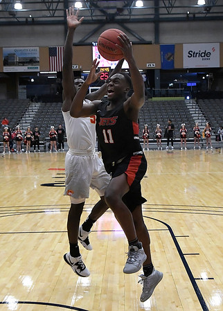 NOC Enid's Ikenna Okeke drives to the basket against New Mexico's Gideon George Thursday, November 14, 2019 during the NOC/Chick-fil-A Classic at the Stride Bank Center in Downtown Enid. (Billy Hefton / Enid News & Eagle)