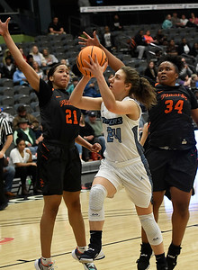 Enid's Claire Dodds drives to the basket against Putnam City's Daja Thomas and Nevaeh Bell Tuesday, November 26, 2019 during the home opener at the Stride Bank Center. (Billy Hefton / Enid News & Eagle)