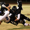 OBA's Cooper Thorton and Jett Cheatham knock Healdton's Austin Perdue off his feet during the first round of the Class A playoffs Friday, November 13, 2020 at Oklahoma Bible Academy. (Billy Hefton / Enid News & Eagle)