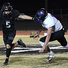 OBA's Jett Cheatham straight arms Healdton's Wade Etter as he carries the ball during the first round of the Class A playoffs Friday, November 13, 2020 at Oklahoma Bible Academy. (Billy Hefton / Enid News & Eagle)