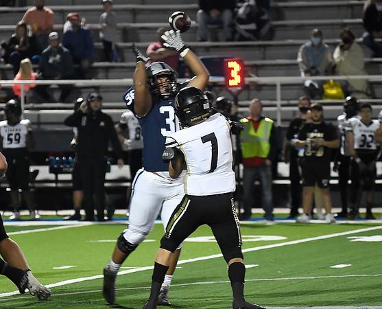 Enid's Romello Washington pressures Broken Arrow's Jake Raines Friday, November 6, 2020 at D. Bruce Selby Stadium. (Billy Hefton / Enid News & Eagle)