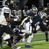 Enid's Tykie Andrews tries to keep his balance after catching a pass against Broken Arrow Friday, November 6, 2020 at D. Bruce Selby Stadium. (Billy Hefton / Enid News & Eagle)