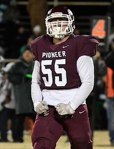 Pioneer's Jacob Smith lets out a yell after making a sack against Quinton during the class B state playoffs Friday, November 27, 2020 at Pioneer High School. (Billy Hefton / Enid News & Eagle)