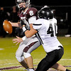 Pond Creek-Hunter's T.J. Krittenbrink sacks Garber quarterback Jordan Avants, Friday at Garber High School. (Staff Photo by BILLY HEFTON)