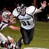 Pond Creek-Hunter's Brady Krittenbrink eludes Garber defenders Friday at Garber High School. (Staff Photo by BILLY HEFTON)