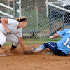 Enid Pacers' Kaitlin Bell beats the tag at third by Woodward's Kameron Pope Monday during Senior Night at Pacer Field. (Staff Photo by BONNIE VCULEK)